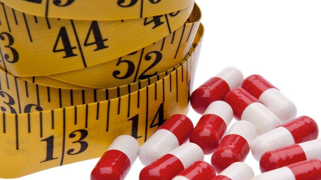 Uống thuốc giảm cân